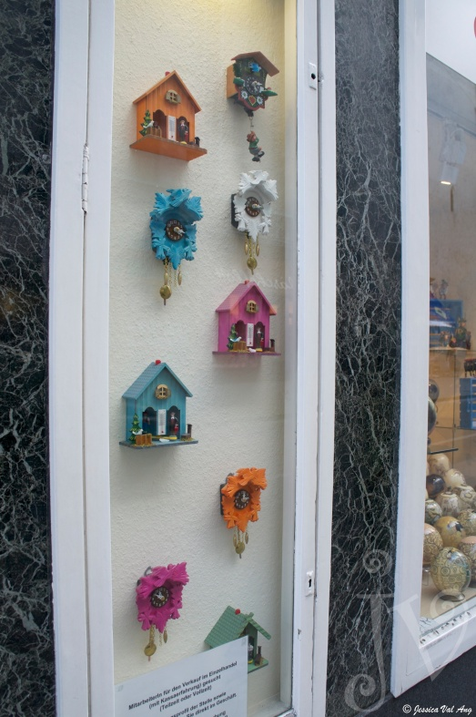 Cute mini clocks in a window.